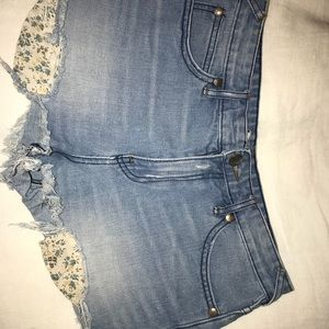 Free people denim shorts with floral pockets